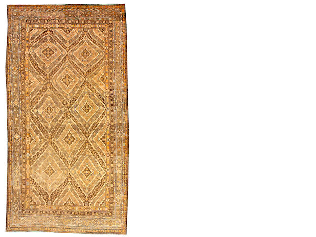 A Khotan long carpet Turkestan, size approximately 8ft. 8in. x 16ft. 10in.