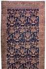 A Lavar Kerman carpet South Central Persia, siza approximately 11ft. 8in. x 21ft. 7in.