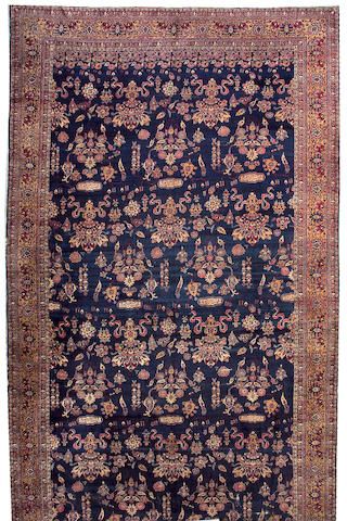 A Lavar Kerman carpet South Central Persia, size approximately 11ft. 8in. x 21ft. 7in.