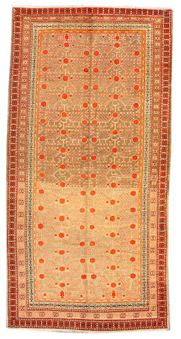 A Khotan rug Turkestan, size approximately 6ft. 10in. x 13ft. 6in.