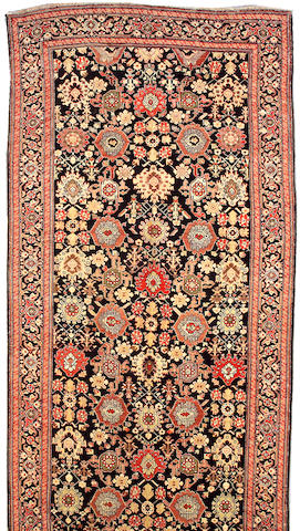A Karabagh long carpet Caucasus, size approximately 6ft. 10in. x 19ft. 5in.