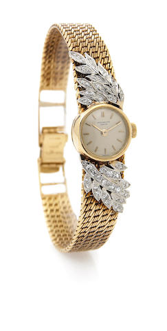 Patek Philippe. A lady's 18k gold and diamond set bracelet watch Ref.3266/14, Case No.2623075, Movem