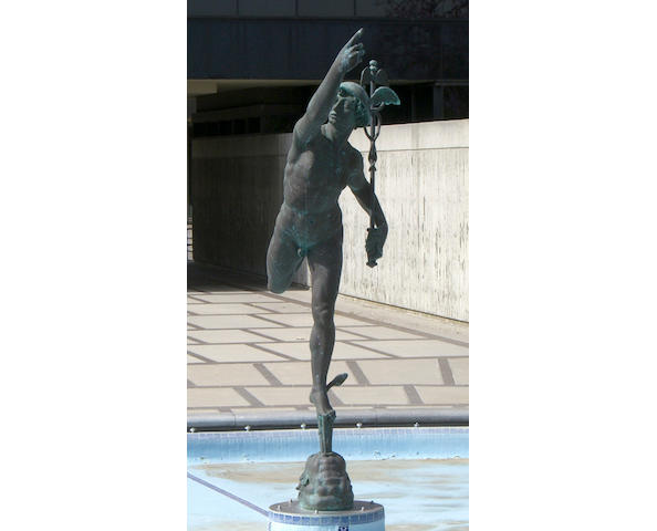 A monumental and imposing patinated bronze figure of Mercury