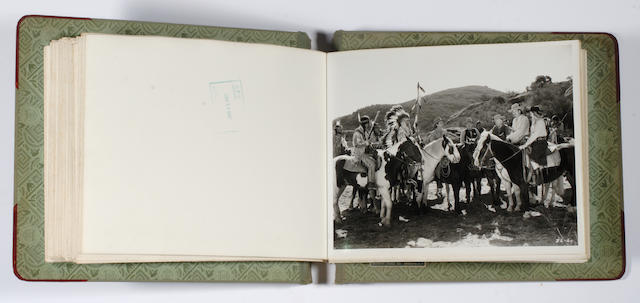 """A Richard Arlen personally-owned keybook of black and white stills from """"Buffalo Bill Rides Again"""""""