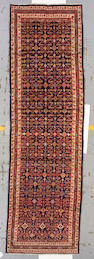 A Malayer runner  Persia, size approximately 3ft. 9in. x 12ft. 10in.