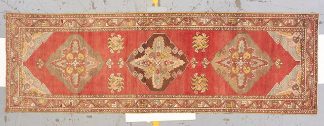 An Oushak runner West Anatolia, size approximately 3ft. 7in. x 11ft. 2in.