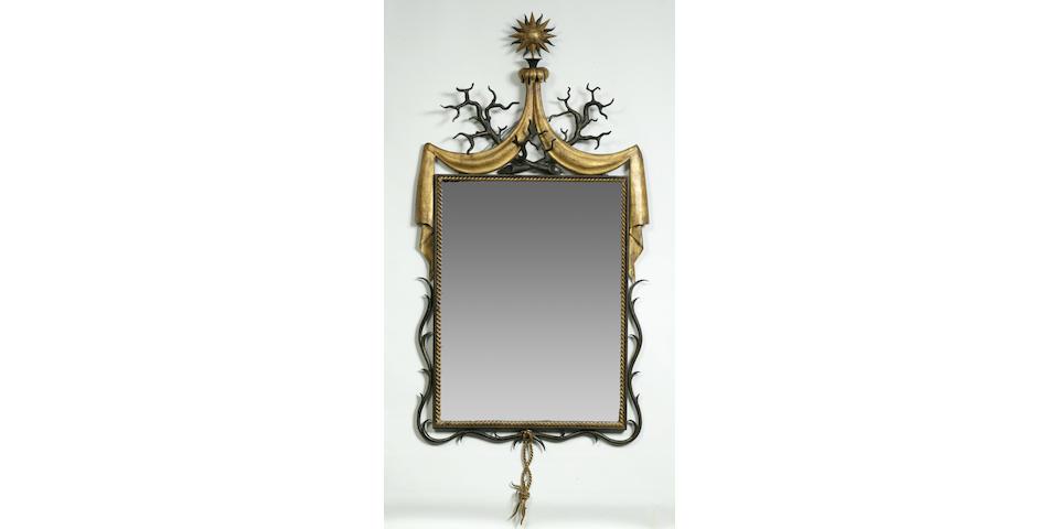 A fine Gilbert Poillerat parcel-gilt wrought-iron mirror