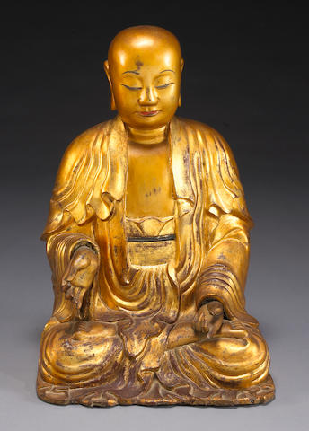 A large gilt dry lacquer Buddhist image 18th Century
