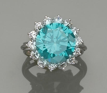 An irradiated blue-green diamond, diamond and platinum ring