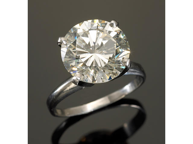 A diamond and platinum solitaire ring