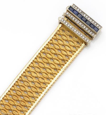 A retro sapphire, diamond and eighteen karat gold buckle bracelet