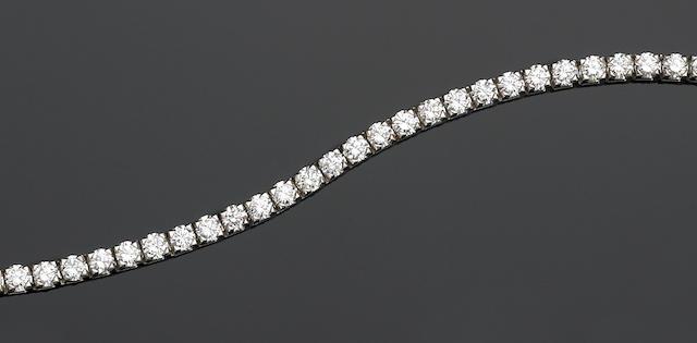 A diamond and eighteen karat white gold line bracelet