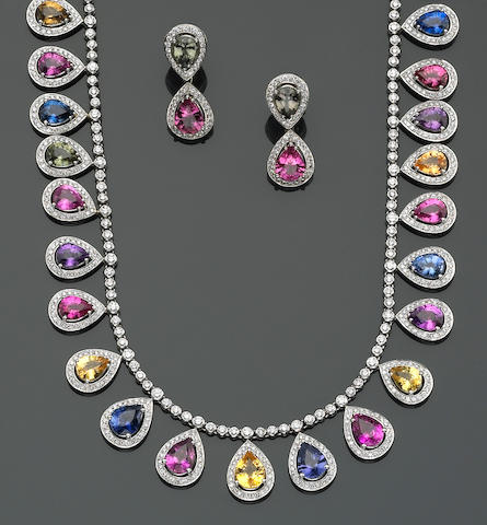 A multi-colored sapphire, diamond and platinum necklace with matching earrings