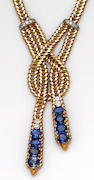 A sapphire, diamond, platinum and eighteen karat gold necklace