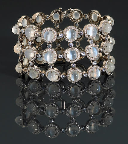 A moonstone, sapphire, diamond, and eighteen karat white gold bracelet