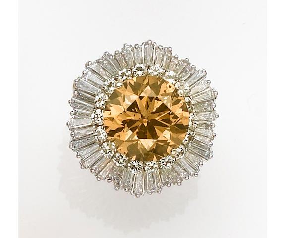 A colored diamond, diamond and platinum ring