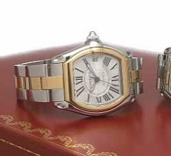 Cartier. A large tonneau-shape stainless steel and 18k gold self-winding calendar bracelet watchRoadster, Ref.2510, circa 2005