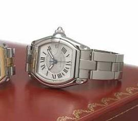 Cartier. A large tonneau-shape stainless steel self-winding calendar bracelet watch Roadster, Ref.2510, circa 2005