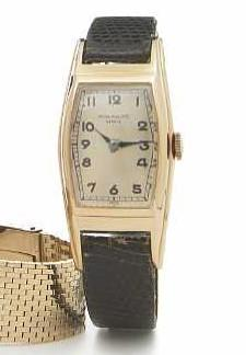 Patek Philippe. An 18k rose gold tonneau shape wristwatch in custom made caseMovement No.196828, circa 1922
