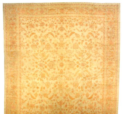 An Oushak carpet West Anatolia, size approximately 14ft. x 15ft. 8in.