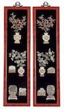 A pair of lacquered wood wall plaques with jade, hardstone and ivory inlay decoration