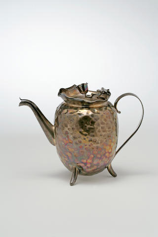 A good Christopher Dresser dappled silver teapot