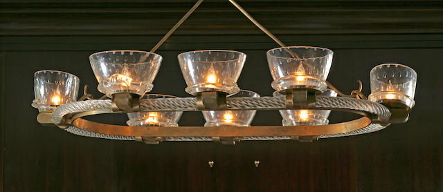 An Italian gilt-bronze and glass eight-light chandelier
