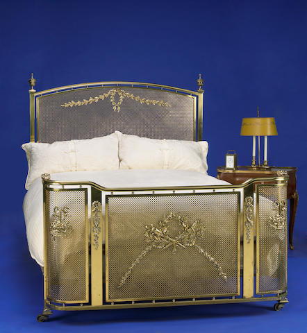 A Neoclassical style brass bed