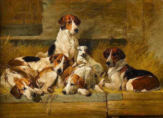 John Emms (British, 1843-1912) Foxhounds and a hunt terrier on a bench 20 x 26 3/4 in. (51 x 68 cm.)