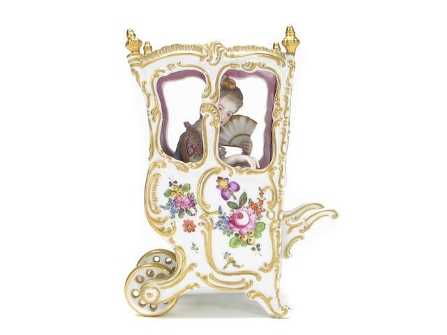 A Meissen style porcelain sedan chair