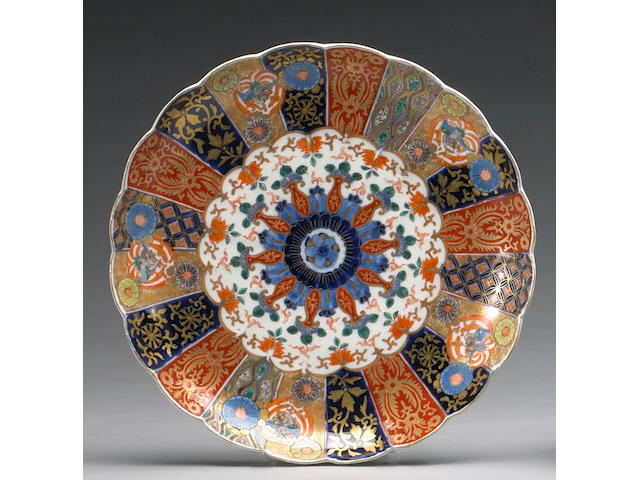 A set of eight large Imari porcelain kiku-form chargers
