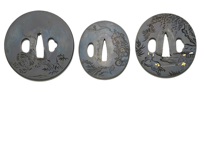 Three shibuichi tsuba with engraved designs Edo period (19th century)