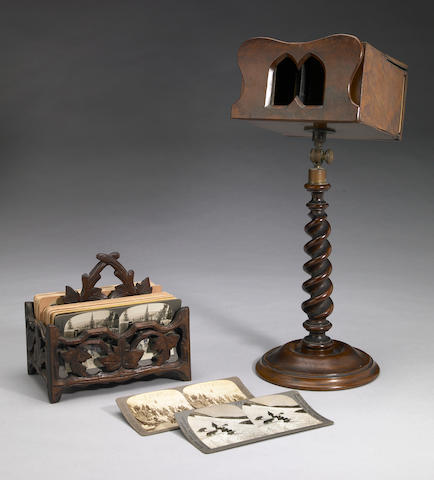Group of fifty-two stereoscopic cards and walnut viewer on stand
