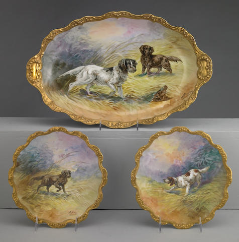 Set of eight French hand-painted gilt edged porcelain plates together with a serving dish Limoges 19th century