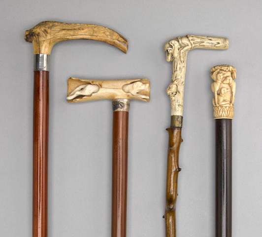 A group of four Continental dog themed canes