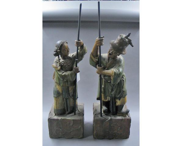 A pair of polychrome glazed pottery figures Circa 1920