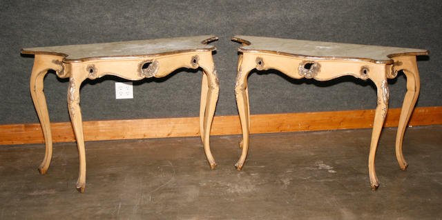 A pair of Italian Rococo style parcel gilt, faux marble  painted console tables
