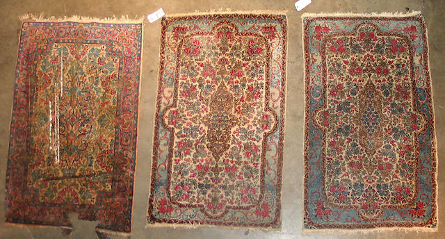 Three Kerman rugs size approximately 3ft. x 4ft. 10in. and the pair 2ft. 11in x 4ft. 10in.