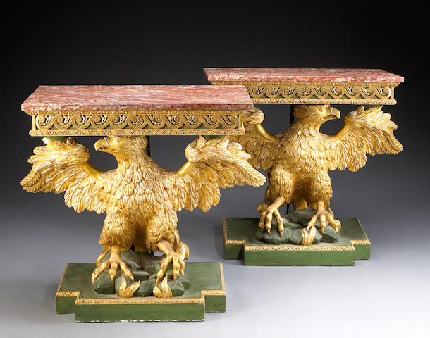 A pair of George III style giltwood and marble topped console tables