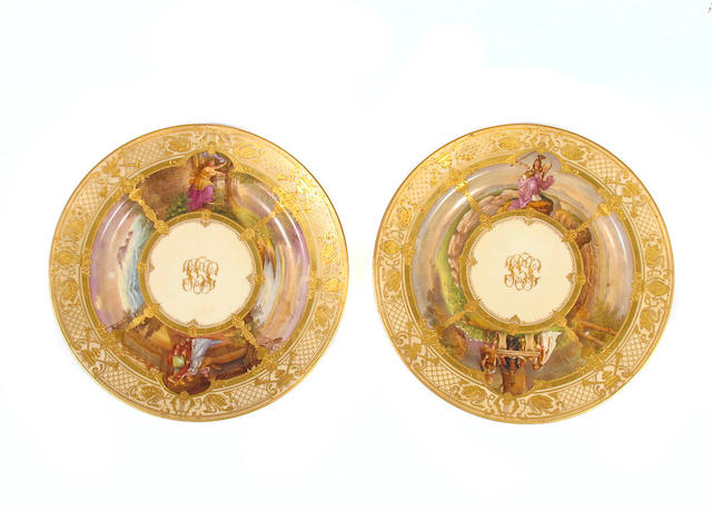 A pair of Dresden style paint decorated porcelain plates