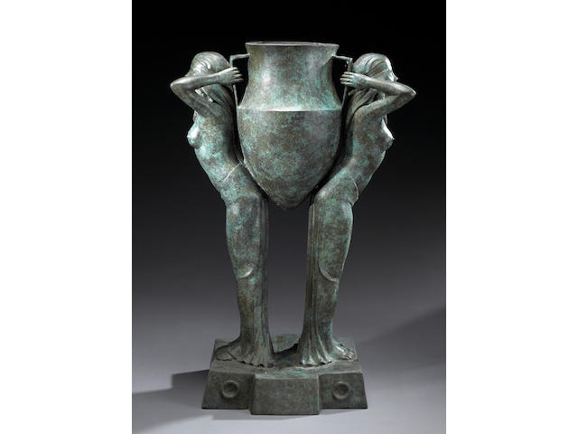 An Art Deco Style patinated bronze figural jardinière in the Egyptian Revival taste