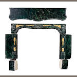 A Régence style gilt bronze mounted marble fireplace surround