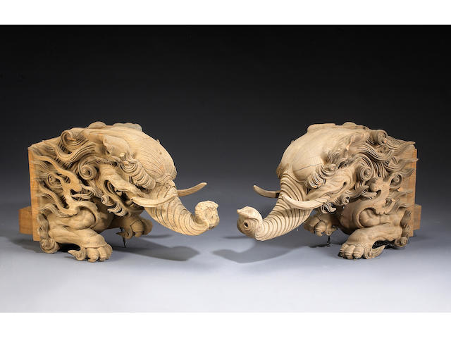 A pair of carved elmwood roof terminals in the shape of baku heads Japan, Meiji Period