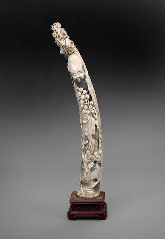 A tinted ivory immortal with peach branch