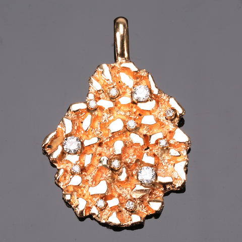 A diamond and fourteen karat gold pendant,