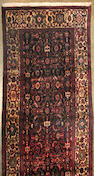 A Malayer runner size approximately 3ft. 5in. x 9ft. 5in.