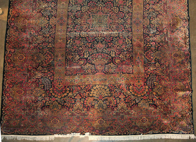 A Kerman carpet size approximately 10ft. 8in x 12ft. 6in.