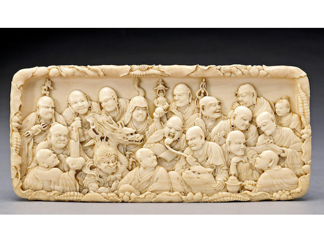 A fine ivory plaque depicting the eighteen rakan By Mitsutoshi, Meiji Period