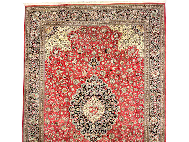 A silk Qum carpet Central Persia, size approximately 13ft. 5in. x 19ft. 2in.