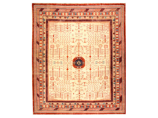 A Chinese carpet China, size approximately 10ft. x 11ft. 10in.